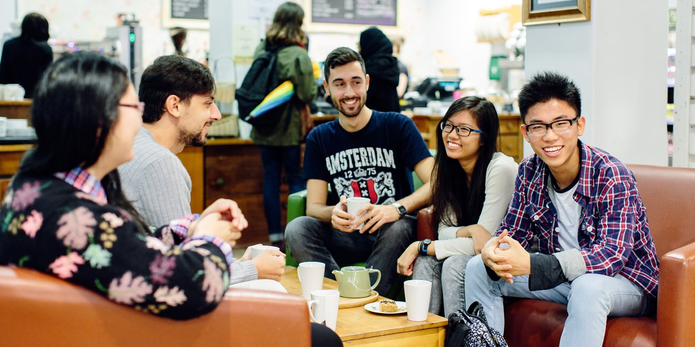 International students catching up over coffee at the Global Cafe.
