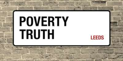 Poverty Truth street sign