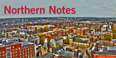 "Decorative image: northern cityscape from above, with ""Northern Notes"" written in red across a grey sky."