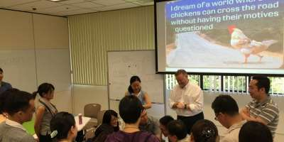 Photo of Roger Slee leading a workshop at a Summer School (Hong Kong University). Photo courtesy of Simon T.M. Ng.