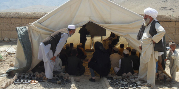 Classroom tent with students, image courtesy of Caroling Dyer