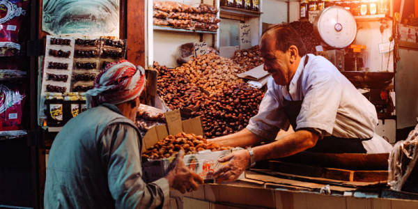 Man selling dates at a market