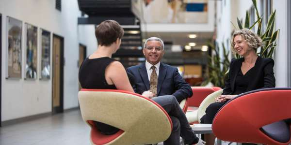 academic staff in seating area in the Liberty Building