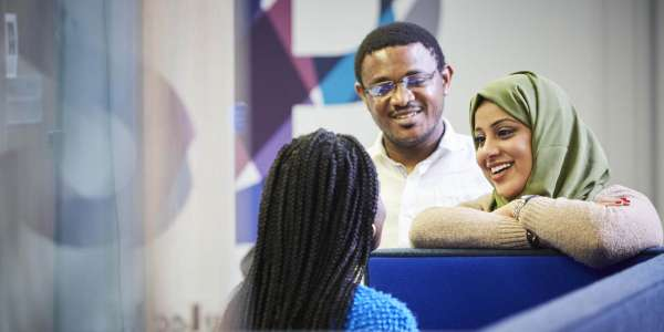 Postgraduate students in the Social Sciences building