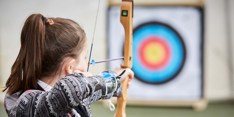 Student learning archery