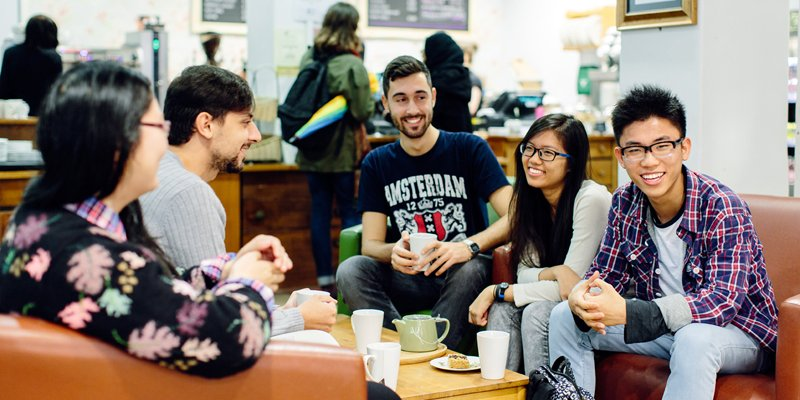 International students catching up over coffee at the Global Cafe