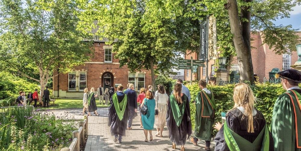 University of Leeds graduates in robes in summer